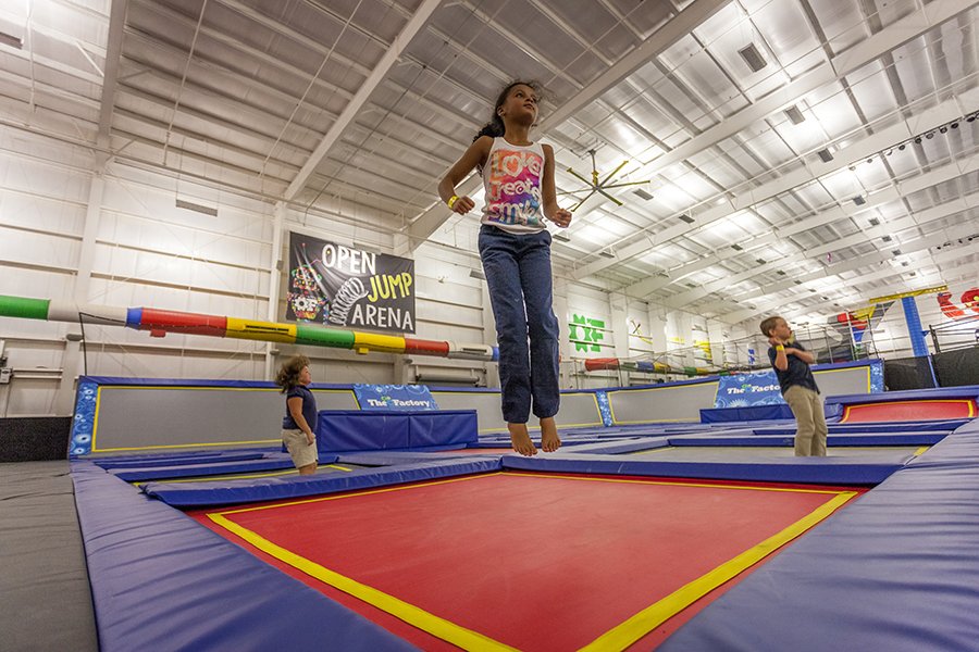 kids jumping on trampolines at the factory