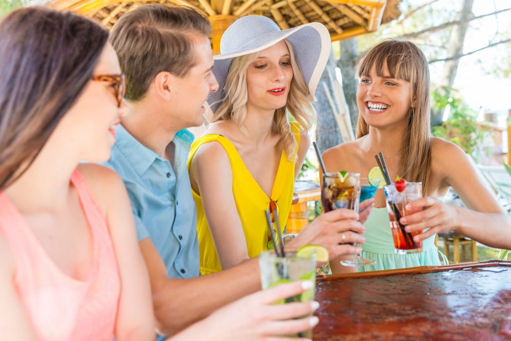 friends enjoying drinks at an outdoor bar
