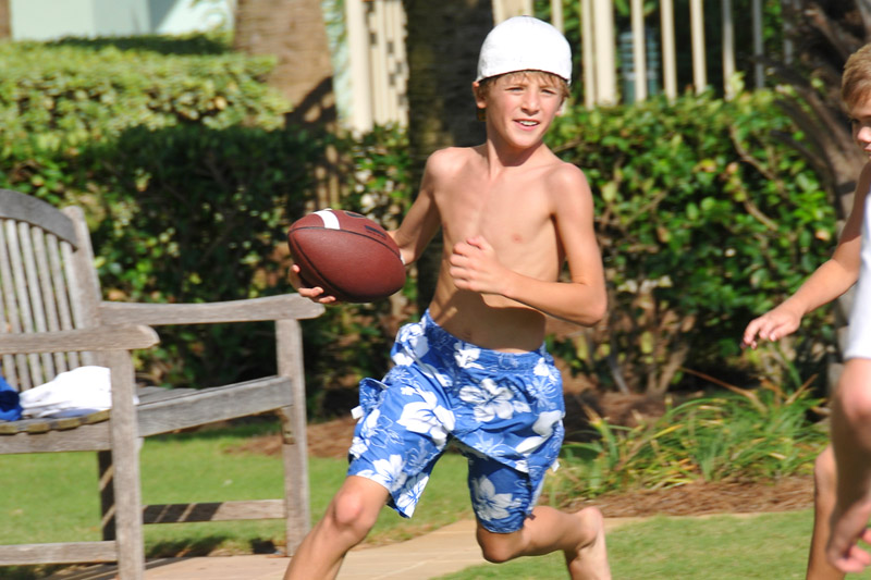 Boys play Football at Turquoise Place in Orange Beach